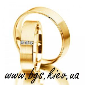 Обручальные кольца с тремя камнями желтое золото 18-жз