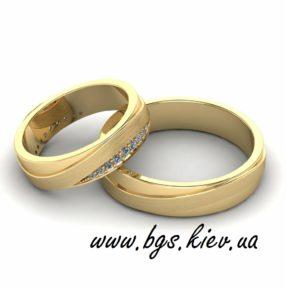 Свадебные кольца желтое золото с камнями Swarovski
