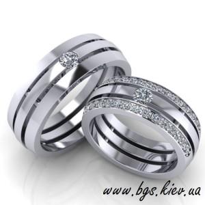Обручальные кольца из белого золота с бриллиантами «Юпитер. Уникальные обручальные кольца из белого золота «Юпитер» с прорезями. Обручальные кольца из белого золота с бриллиантами «Юпитер» с прорезями, 14-Бз– это великолепныйиуникальный атрибут Вашейсвадьбы. Свадьба – это самое замечательное и незабываемое событие в жизни. Каждой молодой пере важно, чтобы свадебная церемония прошла идеально, поэтому нужно подойти к его планировке тщательно. И, конечно же, к выбору колец нужно подойти со всей ответственность. В этом Вам поможет статья на нашем Обручальные кольца из белого золота с бриллиантами на заказ в ювелирной мастерской сайте, «Советы по выбору обручального кольца» http://bgs.kiev.ua/post_news/kakoye-koltso А после прочтения статьи, можете приступать к выбору модели. Также Вы всегда можете проконсультироваться с нашими специалистами в телефонном режиме или написать на наши электронные адреса. К примеру, Вы выбрали кольца, но считаете, что обручальным кольцам с бриллиантами не хватает определенных элементов, которые, на ваш взгляд, его, у вас есть возможность, внести такие дополнения или изменения в дизайн изделия. Кроме этого, Вы выбираете цвет золота и пробу золота, из которого вы хотите сделать свой заказ, а также, вставки(полудрагоценные или драгоценные камни) для украшения - все это в рамках предоставленного в каталоге дизайна. Любую модель ювелирного украшения можно выполнить в любом цвете золота, по вашему желанию. Оцените как чудные обручальные кольца из белого золота с бриллиантами смотрятся в желто - лимонном цвете.