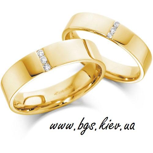 Обручальные кольца с тремя камнями